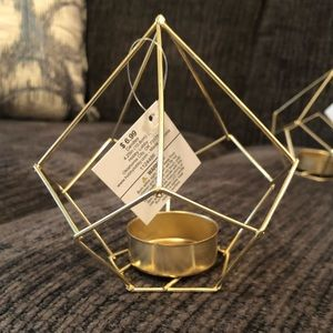 7 Gold Tea Light Holders (all included)